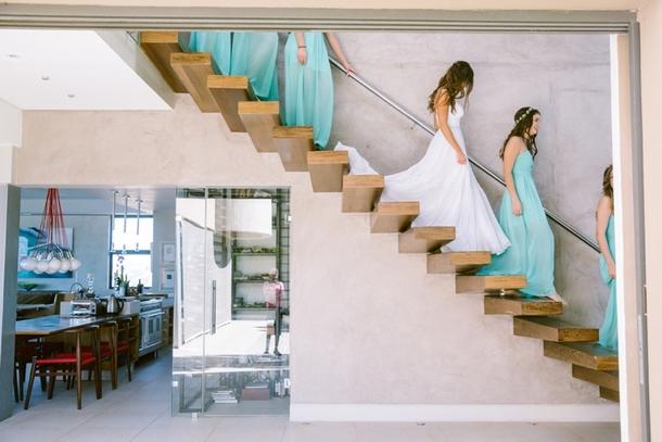 Bridesmaids Descending Staircase | Credit: Lad & Lass