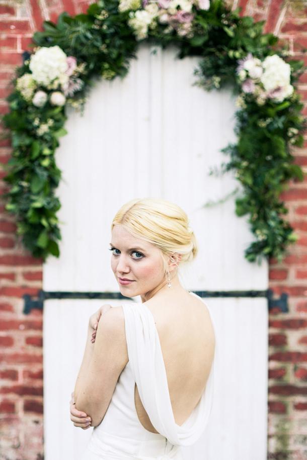Bride in elegant cowl back dress | Credit: Anneli Marinovich (1)