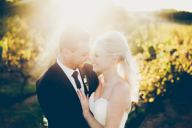 Bride and Groom in Vineyards by Fiona Clair Photography
