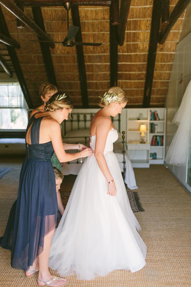Bride Getting Dressed by Kristi Agier
