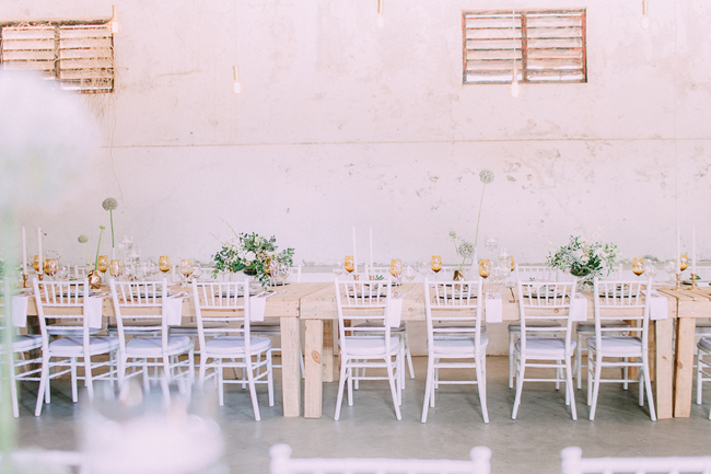 White Tiffany Chairs and Wooden Tables