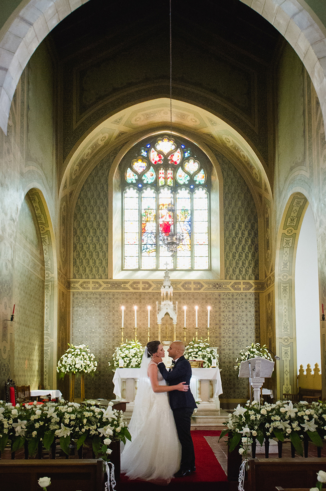 Romantic Stained Glass Wedding Chapel with White Lillies