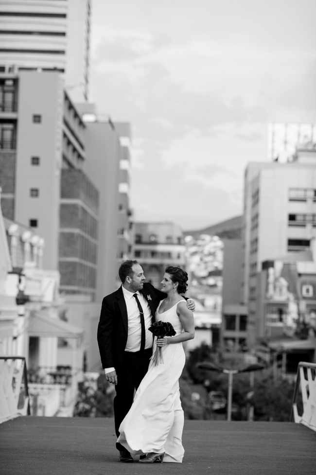 Bride and Groom in City  by Jules Morgan Photography