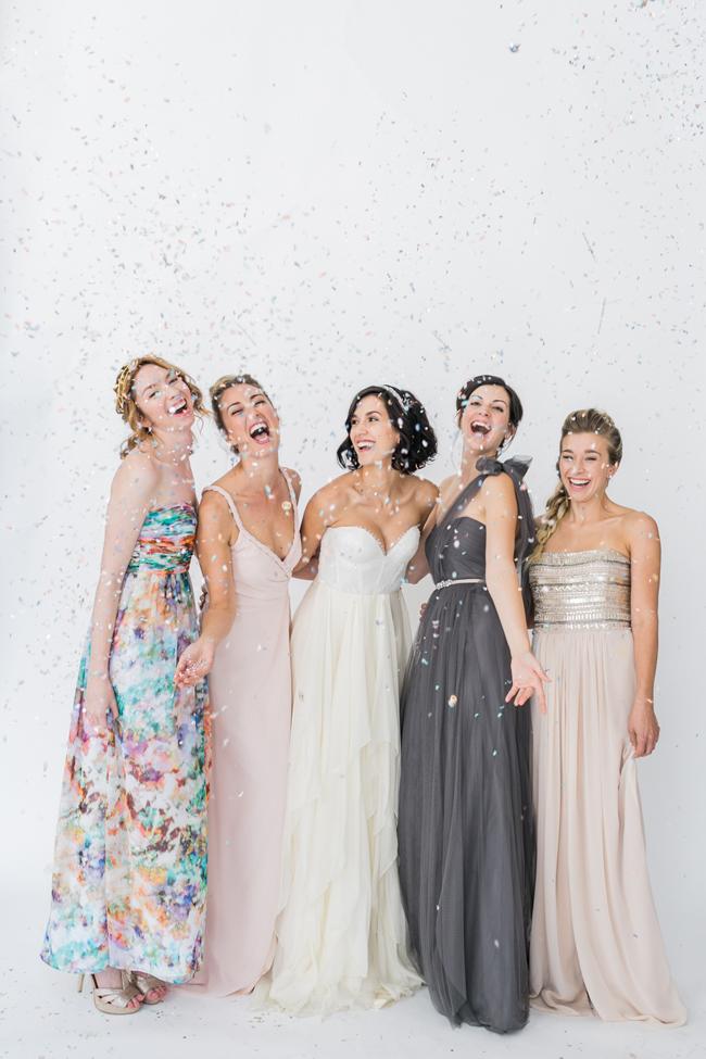 Bridesmaids with confetti | SouthBound Bride | Credit: Alexis June Weddings