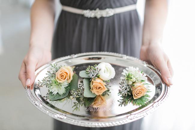 Peach boutonnieres | SouthBound Bride | Credit: Alexis June Weddings