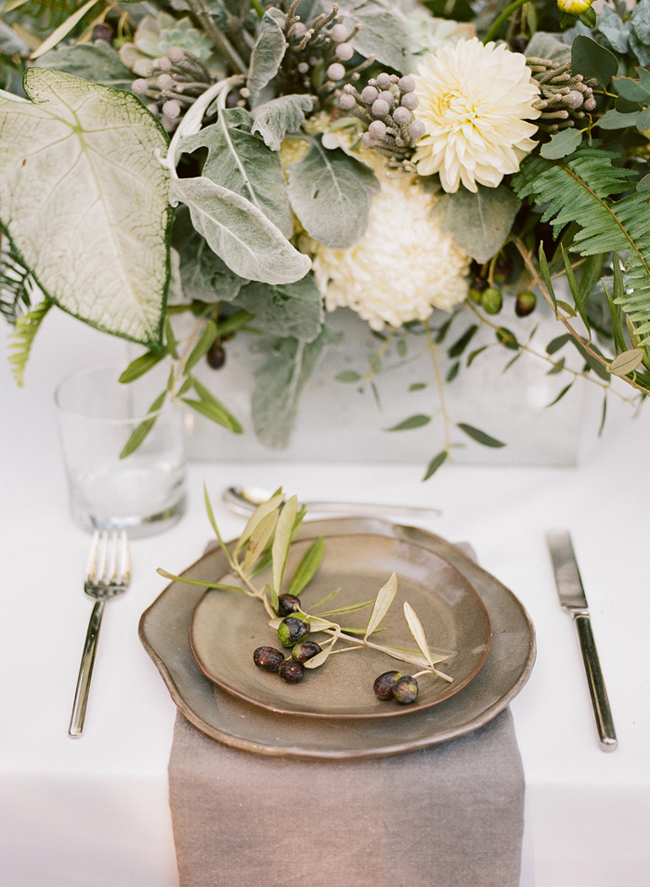 organic industrial wedding place setting with olive decorations