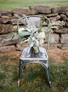 industrial chair with olive leaf and white flower bouquet