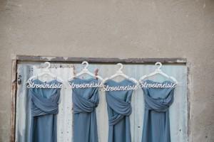 Long Dark Grey Bridesmaid Dresses on Custom Hangers | Credit: Carolien & Ben
