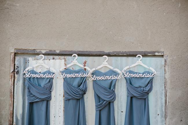 Long Dark Grey Bridesmaid Dresses on Custom Hangers   Credit: Carolien & Ben