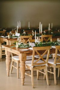 Wooden Tables with Greenery