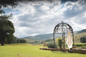 Wedding Dress Hanging from Gazebo | Credit: Those Photos