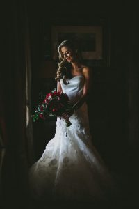 Bride with Red Peony Bouquet | Credit: Knot Just Pics