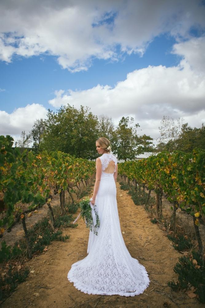 Bride in Keyhole Back Lace Wedding Dress