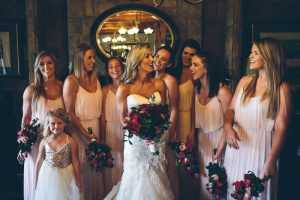 Bridesmaids in Blush with Red Bouquets | Credit: Knot Just Pics