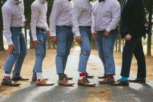 Groomsmen in Pastel Trousers & Mismatched Socks