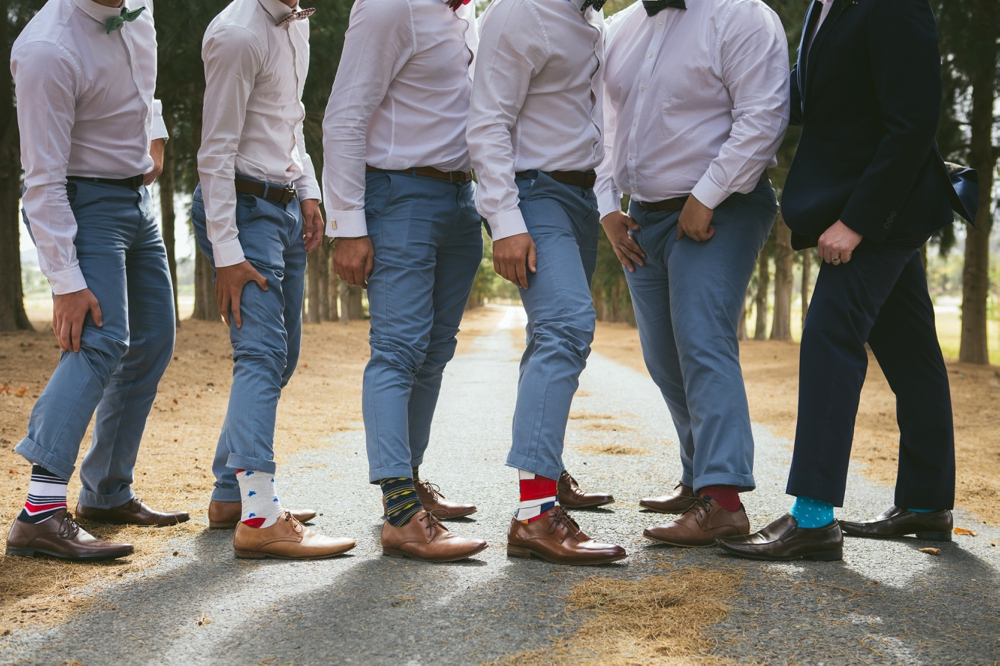 Groomsmen in Pastel Trousers & Mismatched Socks