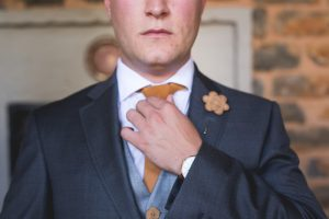 Leather Boutonniere | Credit: Those Photos