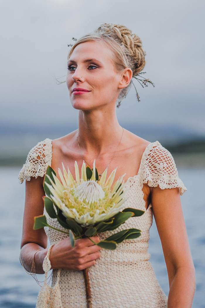 Boho Bride with White King Protea Bouquet   Credit: Bold As Love