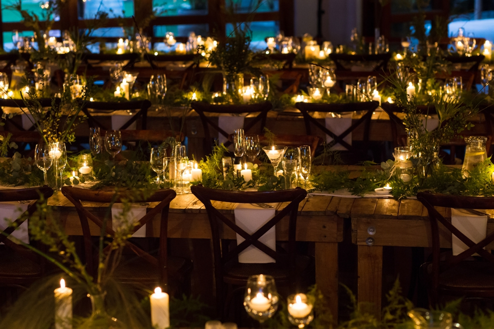 Tables with Greenery Runners and Candles