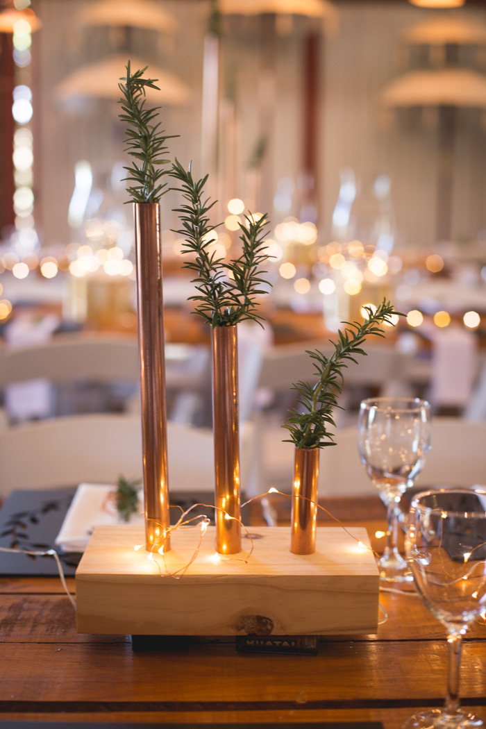 Copper Pipe Vase Centerpiece | Credit: Those Photos