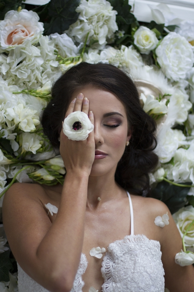 Bride with Anemone & Floral Backdrop | Credit: Mooi Photography