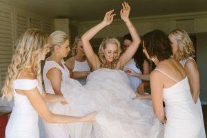 Bridesmaids Helping Bride | Credit: Kikitography