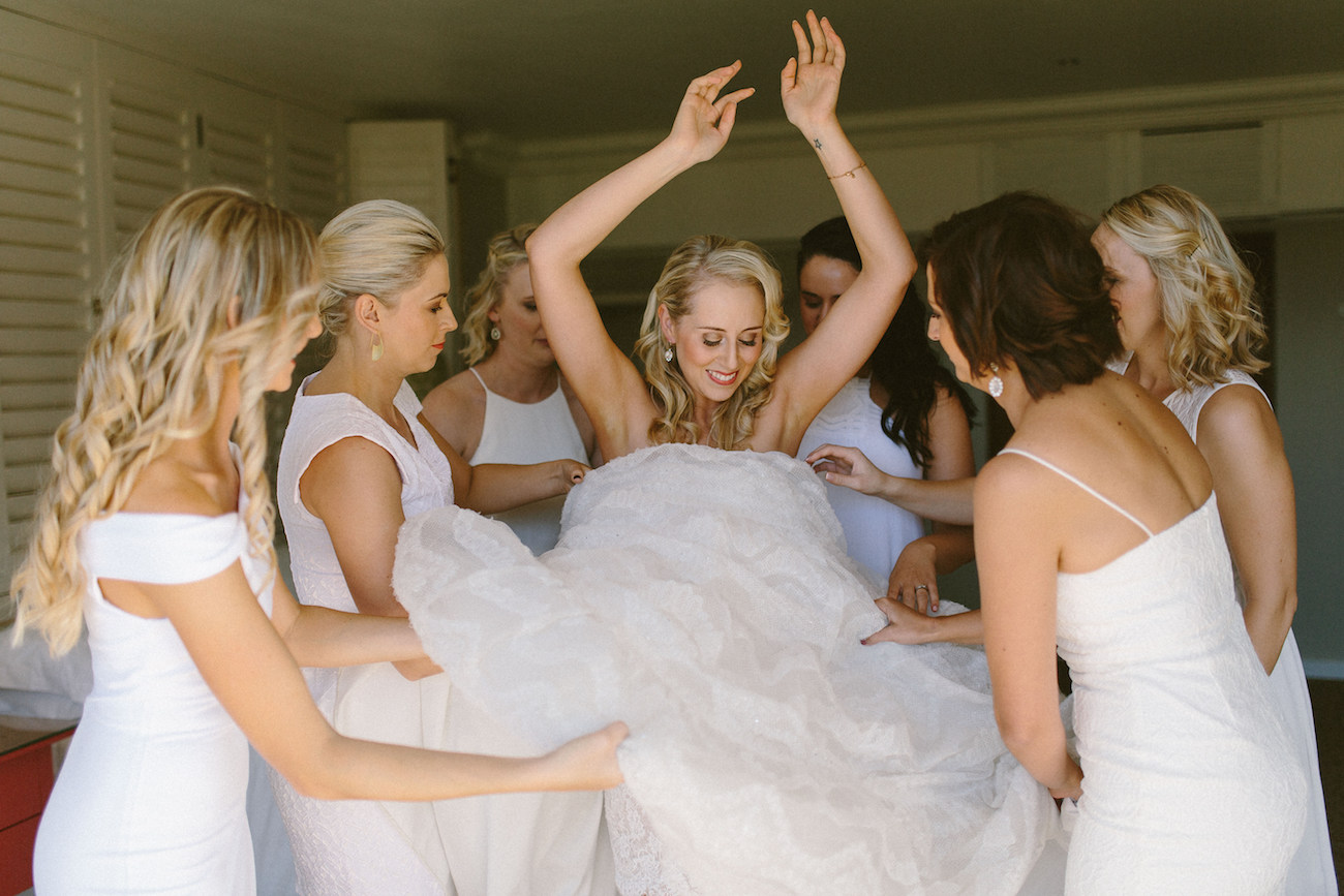 Bridesmaids Helping Bride | Credit: Kikitography