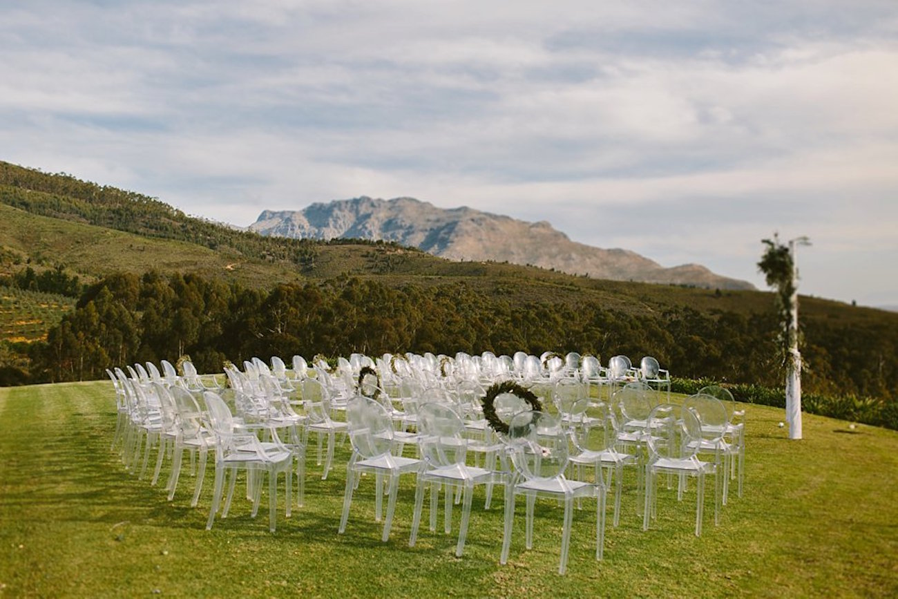 Vineyard Ceremony with Ghost Chairs | Credit: Kikitography