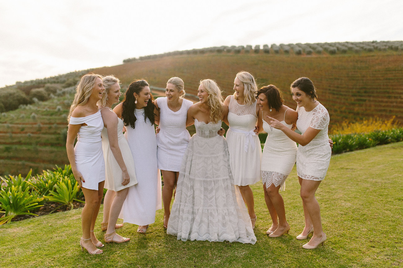 Mismatched White Bridesmaid Dresses | Credit: Kikitography