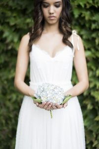 Bride with Hydrangea | Credit: Jack & Jane Photography