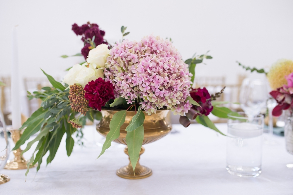 Berry Tone Centerpiece in Gold Vase | Credit: Cheryl McEwan