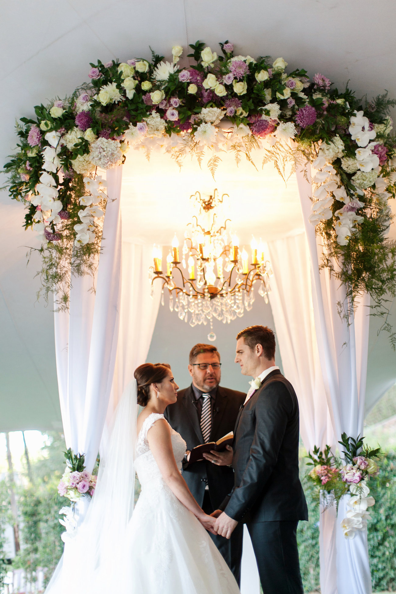 Luxe Draped Floral Arch with Chandelier | Credit: Tyme Photography & Wedding Concepts
