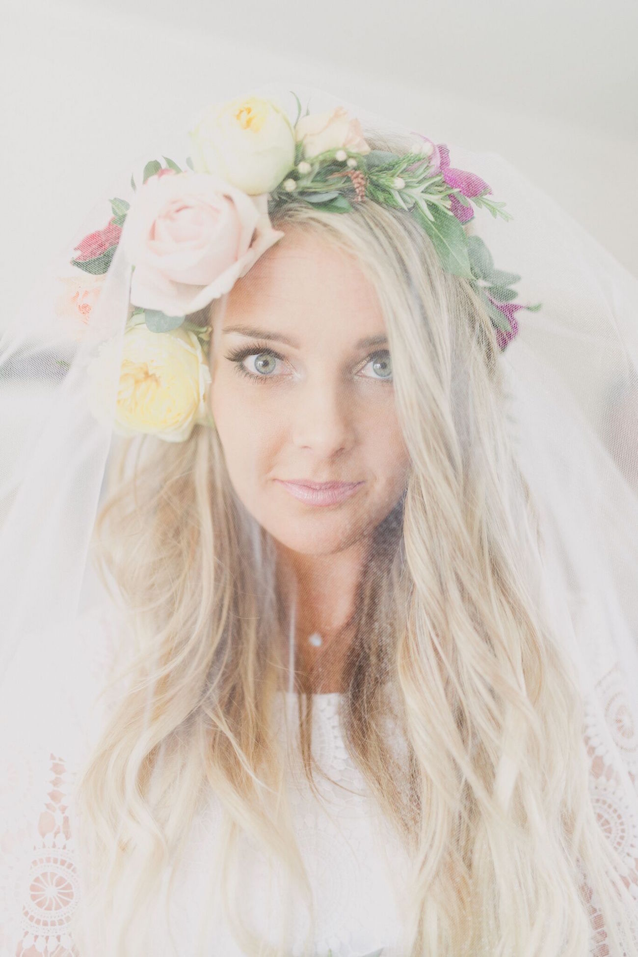 Bride in Flower Crown and Veil | Credit: Vicky Bergallo