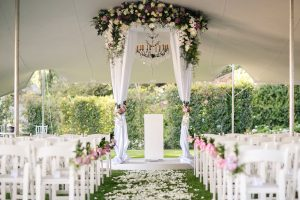 Luxurious Floral Wedding Ceremony Decor with Draped Floral Arch   Credit: Tyme Photography & Wedding Concepts
