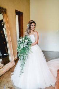 Bride with Cascade Greenery Bouquet | Image: Carla Adel