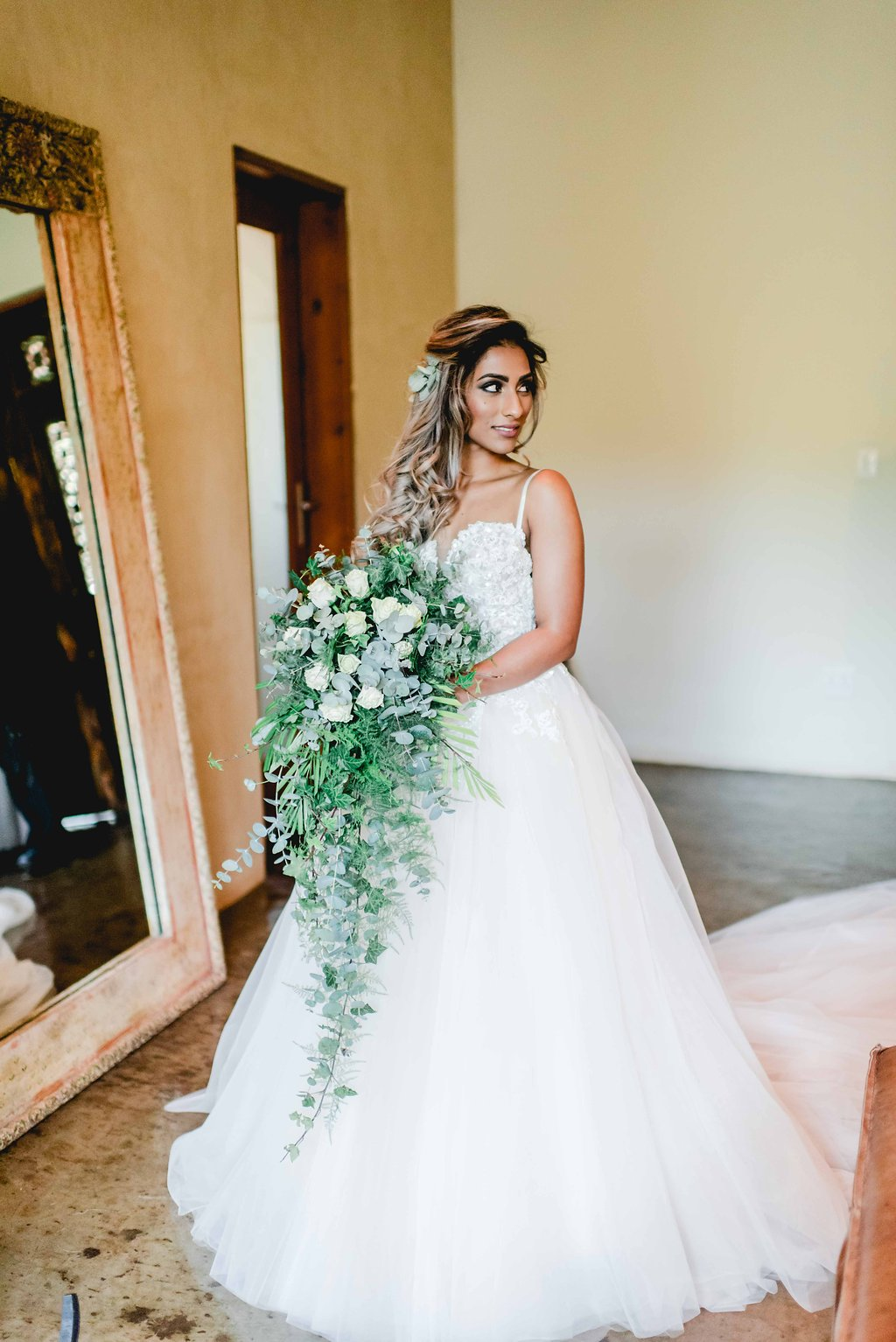 Bride with Cascade Greenery Bouquet | Image: Carla Adel
