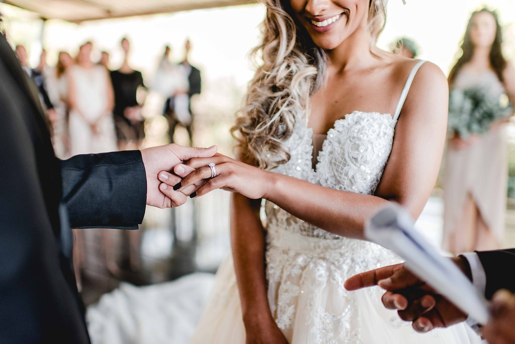Wedding Ceremony Ring Exchange | Image: Carla Adel
