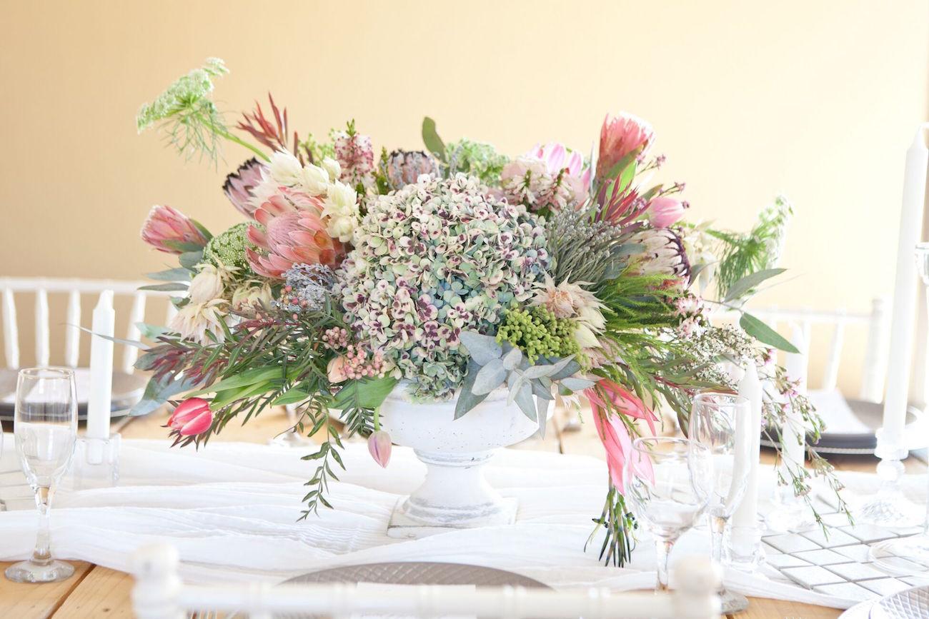 Protea & Hydrangea Centerpiece | Image: Corette Faux