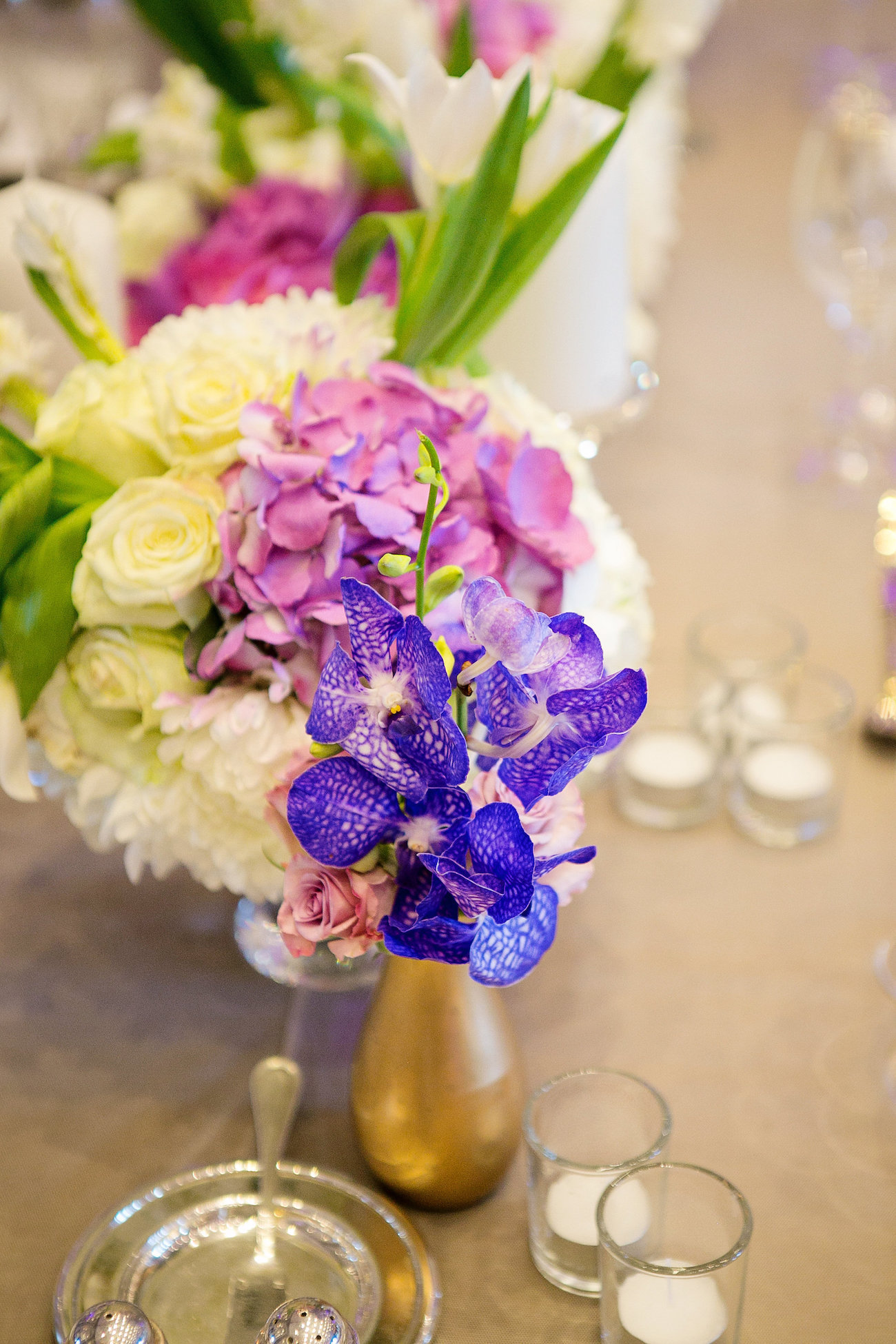 Purple Floral Centerpeice | Credit: Tyme Photography & Wedding Concepts