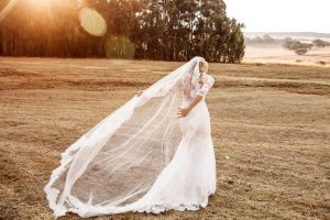 Lace Sleeve Illusion Wedding Dress & Cathedral Veil | Image: Daniel West