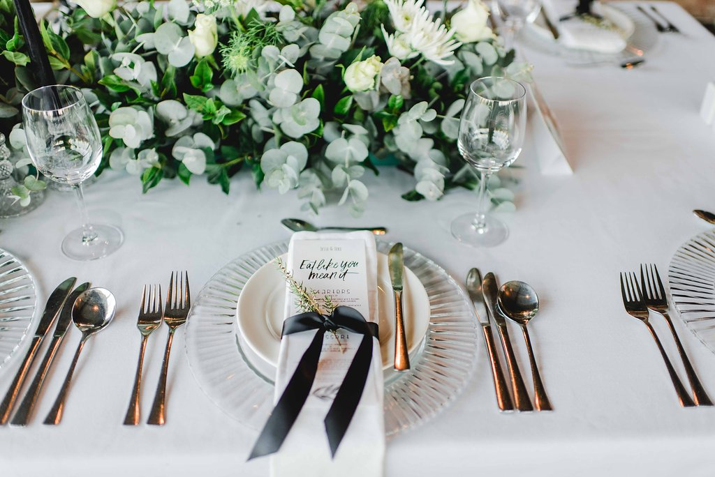 Place Setting with Black Ribbon Tie & Greenery | Image: Carla Adel