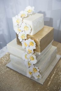 Gold and White Square Wedding Cake | Image: Daryl Glass