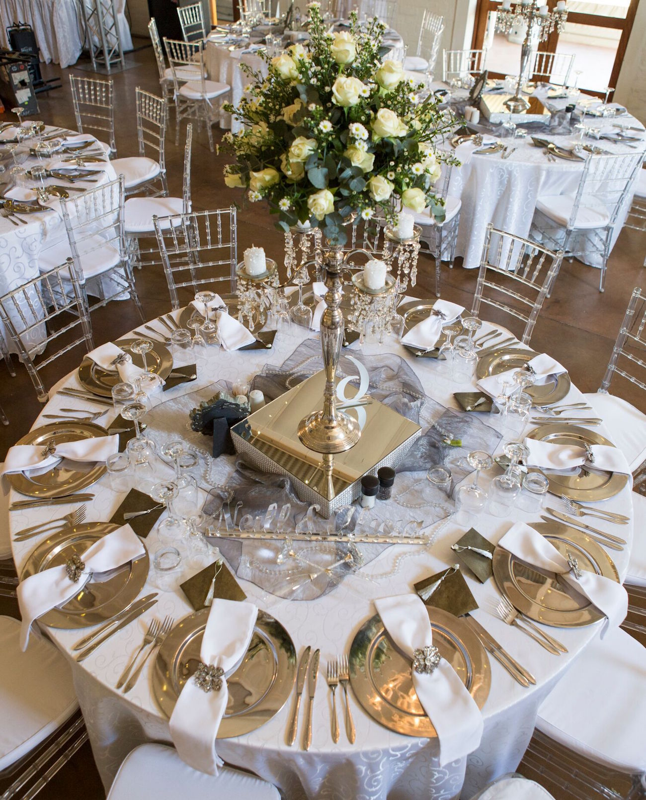 White & Silver Wedding Decor | Image: Daniel West