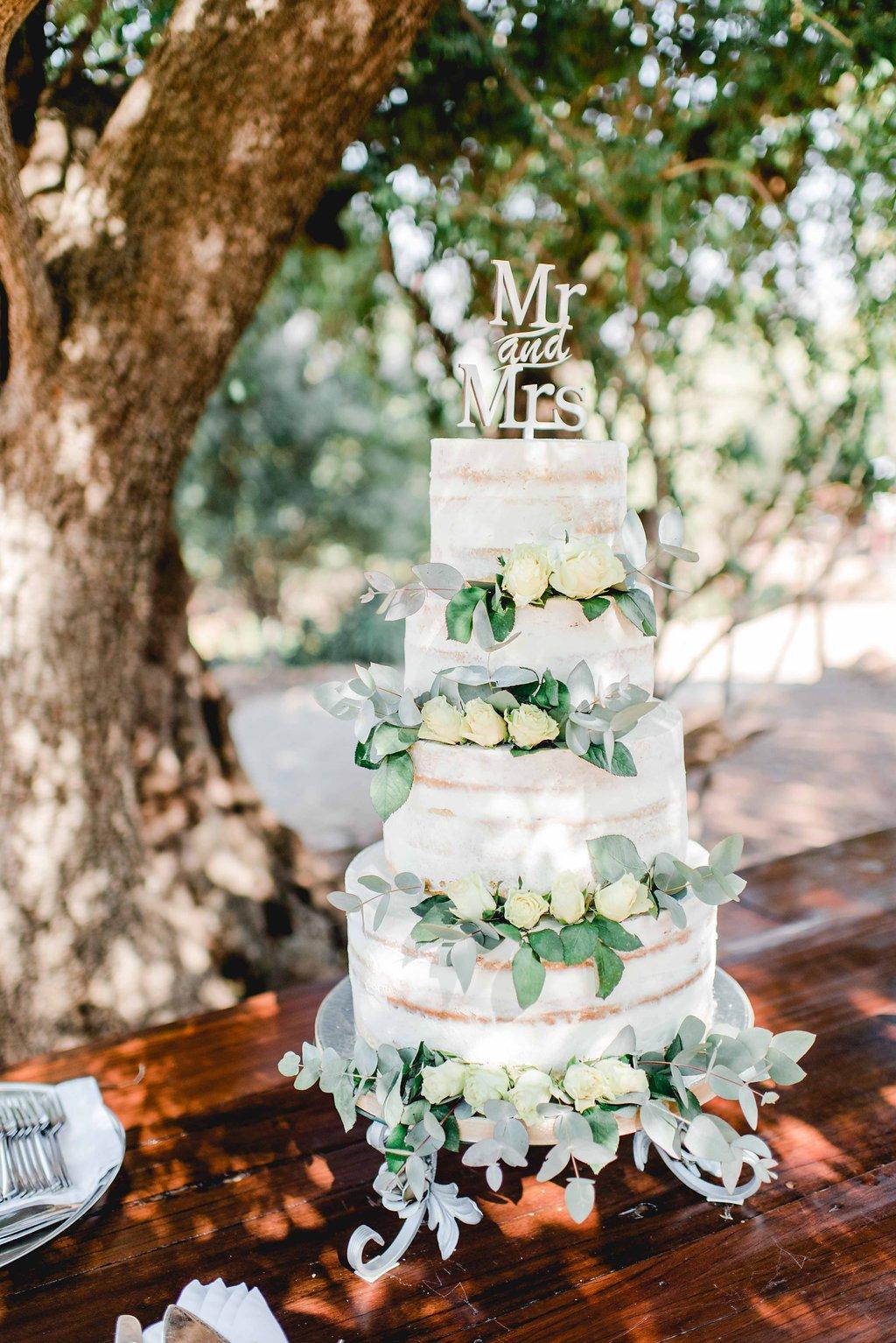 Semi Naked Wedding Cake with White Roses   Image: Carla Adel