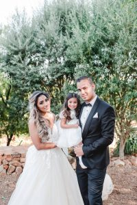 Bride & Groom with Daughter | Image: Carla Adel