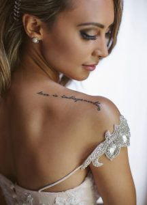 Bride with Shoulder Tattoo | Image: Moira West