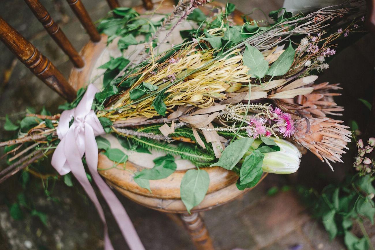 Loose Protea Bouquet | Credit: Oh Happy Day & Roxanne Davison