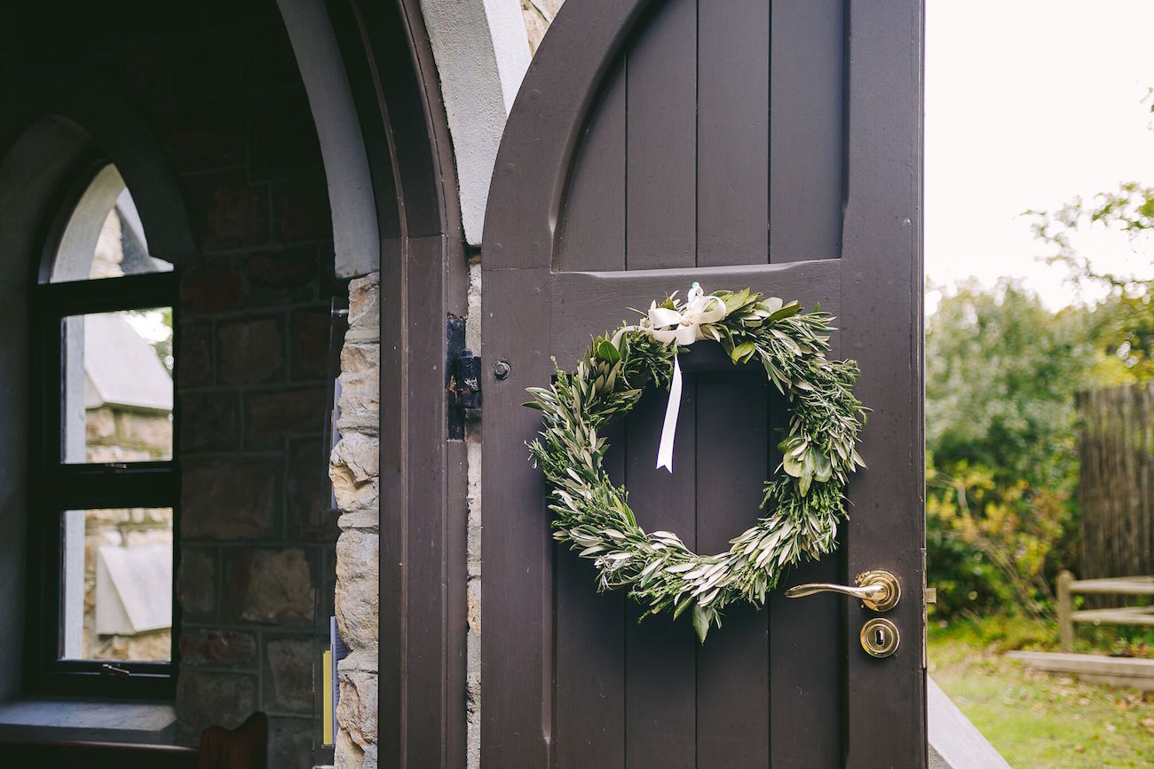 Greenery Wreath Ceremony Decor | Credit: Jani B & Bright and Beautiful