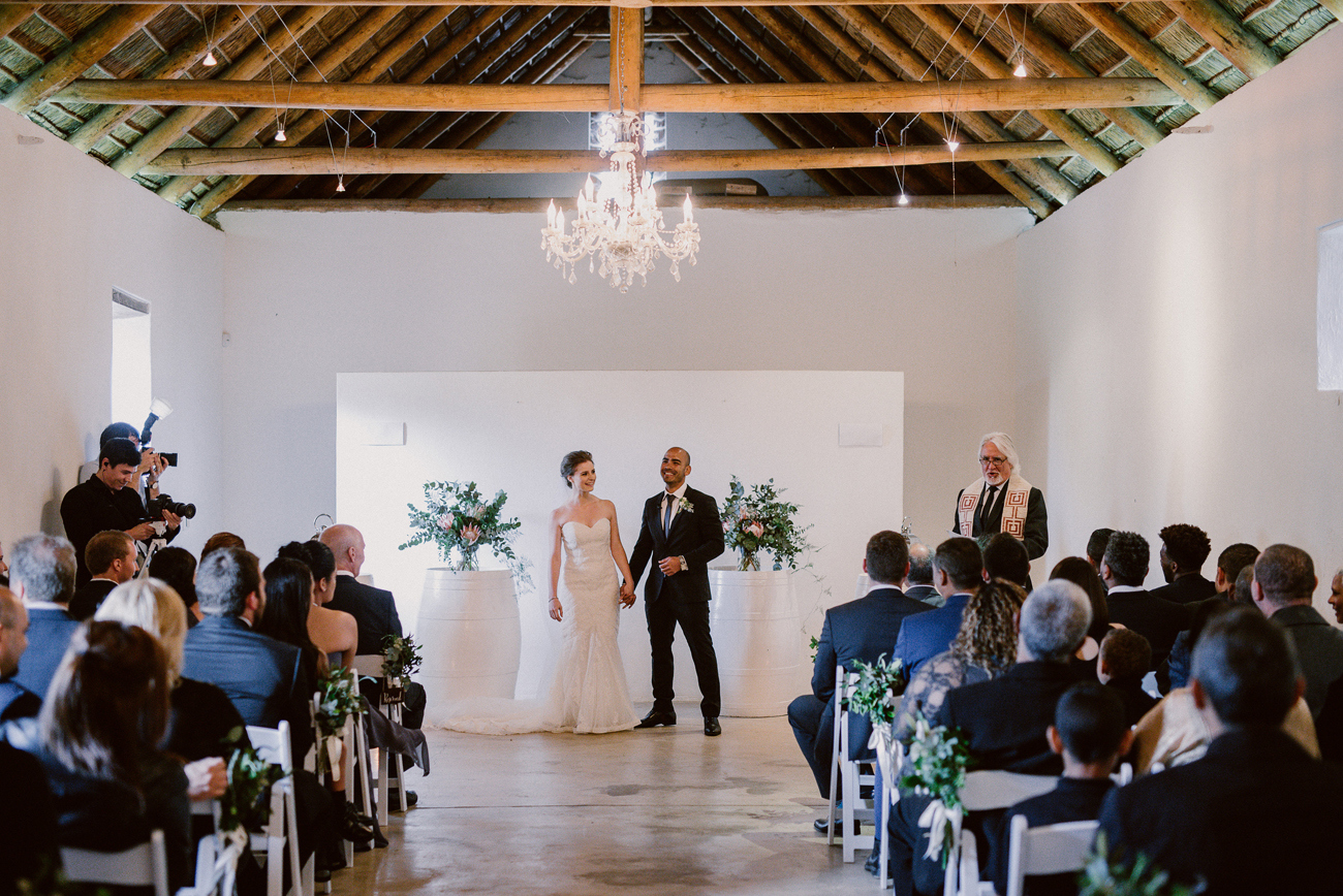 Wedding Ceremony in Wine Cellar | Image: Lad & Lass Photography