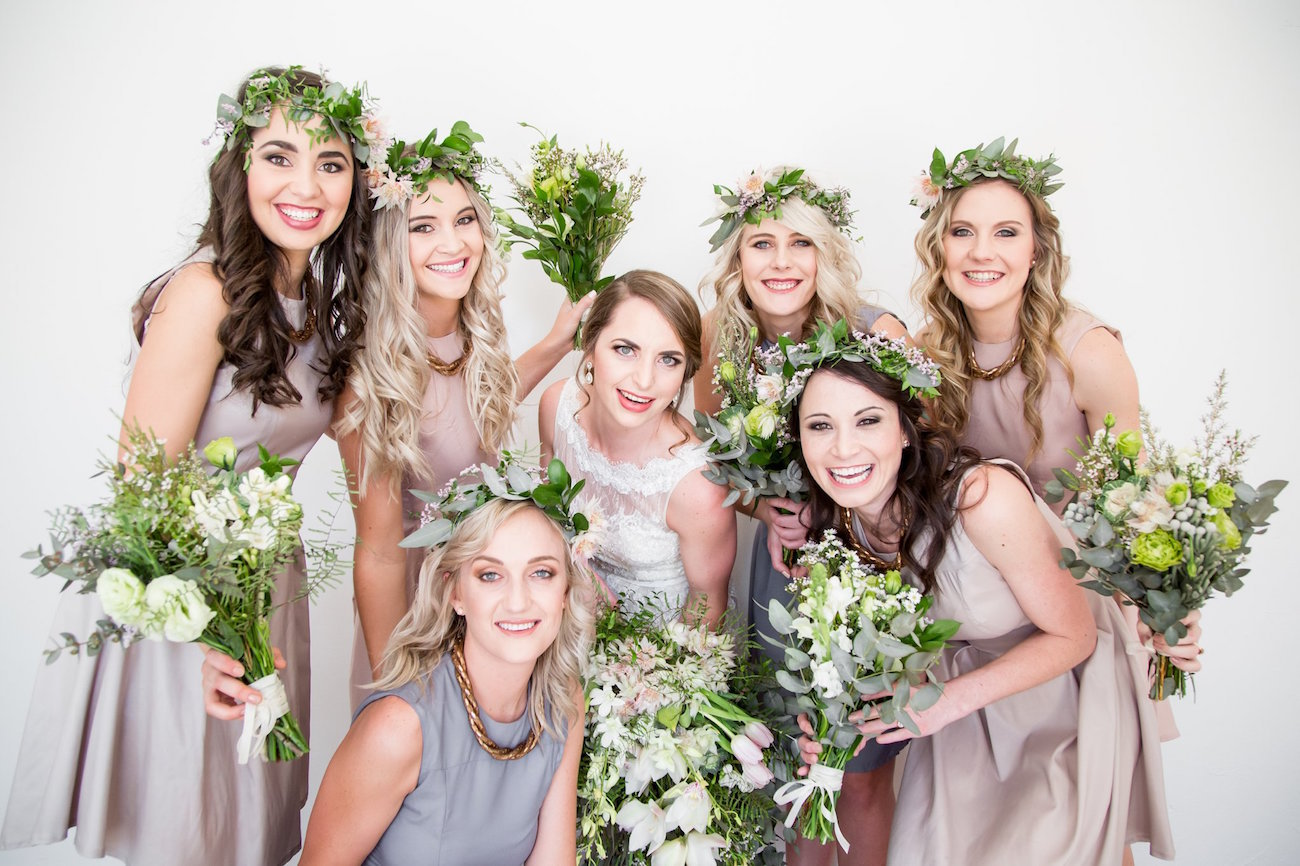 Bridesmaids in Pastel with Greenery Bouquets | Image: JCclick